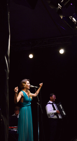 mundi: Soprano Ana Cebotari performs with the Mundi Colour Orchestra at an outdoor concert in the Old Town, Bucharest, 16 September 2015. The concert was part of Bucharests Caragiale festival.