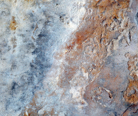 predominantly: Background stone texture, predominantly red and blue