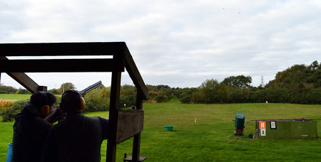 shooter: An instructor supervises a clay pigeon shooter on a range in Fife Scotland
