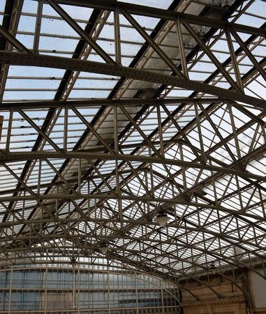 ridged: Glass above curved roof trusses at concourse, Aberdeen Station, Scotland.