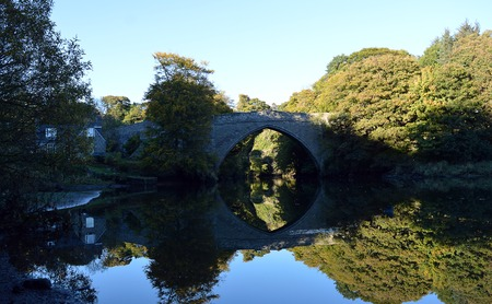 brig: Reflections of Balgownie Brig and surrounding autumnal trees in the River Don, Aberdeen, Scotland