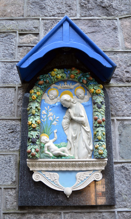 Moulded plaque of Madonna and child outside St Peter RC Church, Castlegate, Aberdeen, Scotland