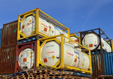 Containers of hydrogen peroxide waiting to be loaded from the quayside at Aberdeen Harbour, Scotland