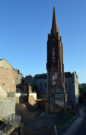 carbuncle: ABERDEEN, SCOTLAND - 22 OCTOBER 2012: After 25 years the A-listed spire still stands alone in the demolished area around the Triple Kirks. Now on the fourth developer, the plan is for the spire to be wedged between two glass student residences. Editorial