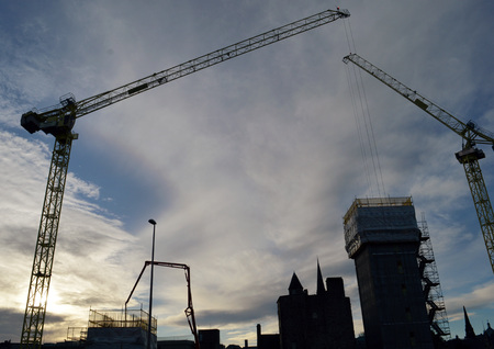 muse: ABERDEEN, SCOTLAND - 11 DECEMBER 2015: As early afternoon winter darkness falls on the city, the MUSE development of Marischal Square around the historic Provost Skenes House continues apace.