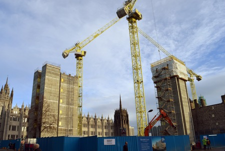 turrets: ABERDEEN, SCOTLAND - 11 DECEMBER 2015: The MUSE development of Marischal Square in front of historic Marischal College takes shape. Editorial