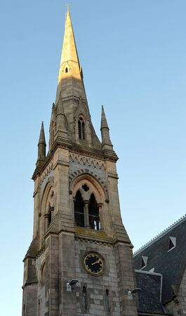 spire: The spire of Gilcomston South Church, Aberdeen, Scotland, glows golden in winter sunlight Stock Photo