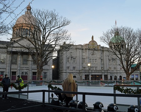 christmas village: ABERDEEN, SCOTLAND: DECEMBER 2015: Skaters enjoy the temporary ice rink set up in the Christmas Village on Union Terrace in front of St Marks Church and His Majestys Theatre .
