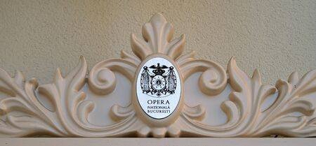 scrollwork: Scrollwork on the outside of the National Opera House ONB displays the buildings crest