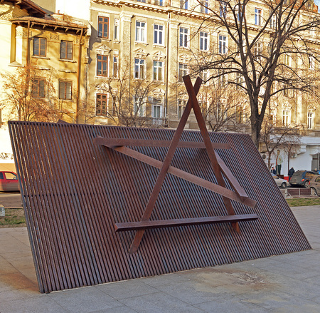 3d star: BUCHAREST, ROMANIA - 3 FEBRUARY 2016: The 3D Star of David installation at the Holocaust Memorial displays the most obvious symbol of Jewishness which Jews were forced to wear in WWII.