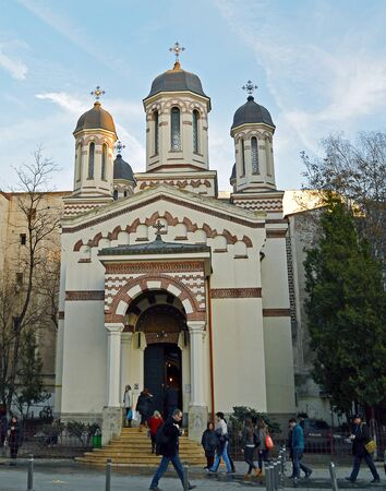 extant: BUCHAREST, ROMANIA - 3 FEBRUARY 2016: The original church of the goldsmiths, still extant between moden buildings in Calea Victoriei, dates to the mid-17th century. Editorial