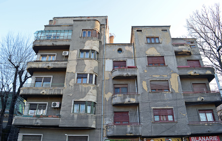 dilapidation: BUCHAREST, ROMANIA - 8 FEBRUARY 2016:  This art deco building is only 20 metres from the stock exchange and is listed as a historic building. How long will it surivive