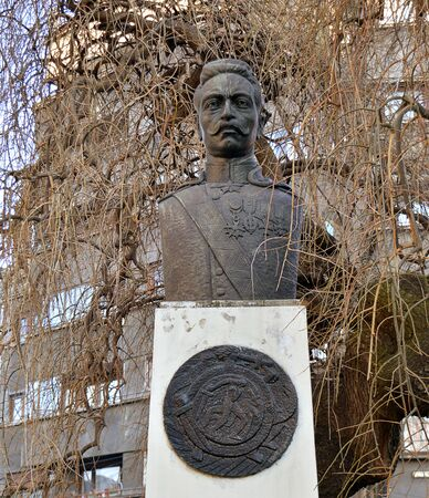 freedom fighter: BUCHAREST, ROMANIA - 9 FEBRUARY 2016:  A somewhat overgrown statue of Armenias national hero General Andranik Andranik Ozanian stands in the grounds of the Armenian church.