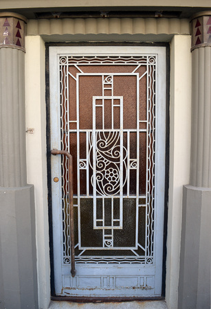 flanked: An art deco door, flanked by art deco columns. in Bucharest, Romania
