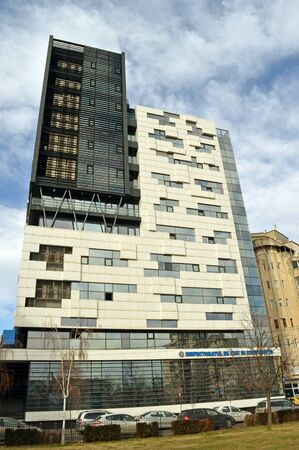 wrath: BUCHAREST, ROMANIA - 15 FEBRUARY 2016: This fine piece of modern architecture houses the body which exercises state control in construction. Like many such organisations it has felt the wrath of DNA anti-corruption investigations.