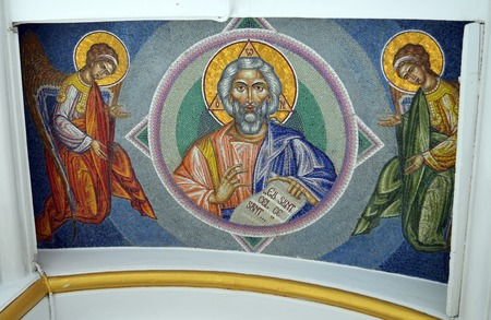 christopher: BUCHAREST, ROMANIA - 15 FEBRUARY, 2016: A mosaic on the roof of the narthex porch welcomes visitors and the faithful to the Romanian Orthodox church of St Mina the eastern St Christopher.