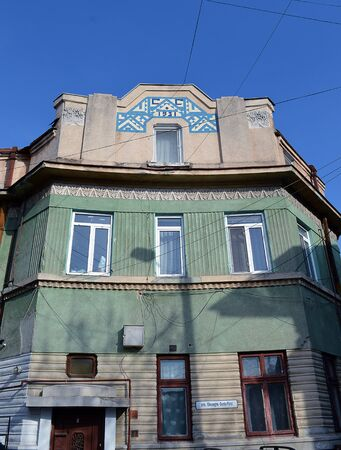 modernist: BUCHAREST, ROMANIA - 21 FEBRUARY 2016: In a dead end in the Popa Nan area of the city stands this unique modernist building, built in 1931 with blue mosaic and art deco frieze.