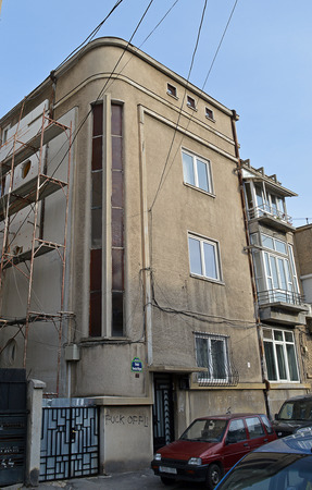 defaced: BUCHAREST, ROMANIA - 23 FEBRUARY 2016: A classic art deco apartment building stands defaced and in need of removation in Strada Mogos Vornicul.