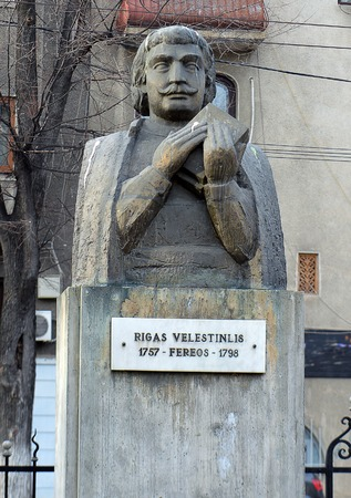 revolutionary: BUCHAREST, ROMANIA - 21 FEBRUARY 2016: A statue of Rigas Feraios or Velestinlis, 18th century Greek political thinker and revolutionary who studied in Bucharest stands outside the Greek temple. Editorial