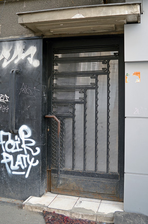 urban decay: A fine art deco door stands out amongst grafitti and urban decay on an abandoned apartment block.