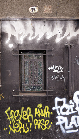 dilapidation: A fine art deco door represents better times among the grafitti and urban decay on an abandoned apartment block in Bucharest, Romania Editorial