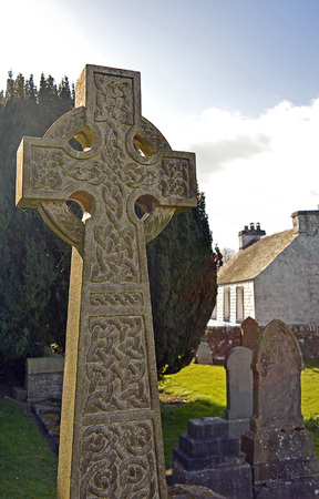 celtic cross: An old spider-webbed Celtic Cross stands in a graveyard in Perthshire, Scotland Stock Photo