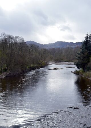 earn: Silvery evening light falls on the River Earn in Comrie, Perthshire. Scotland