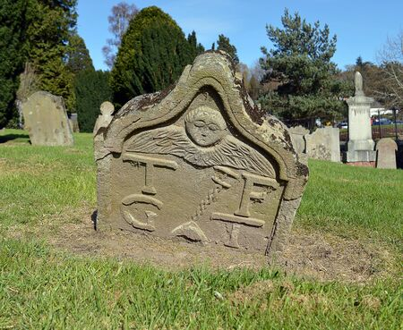 churchyard: An old gravestone in the churchyard of the sixteenth cemtury Kinnoull Old Parish church in Perth, Scotland.