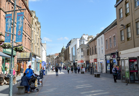 perth: PERTH, SCOTLAND - 19 APRIL 2016:  Shoppers and cafe visitors enjoy the spring sunshine on Perth High Street, Scotland