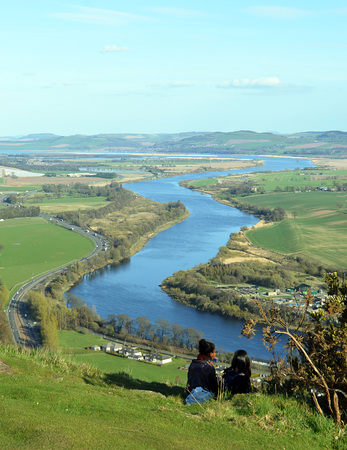 dundee: Two girls watch the River Tay and the A90 road to Dundee from Kinnoull Hill, Perth, Scotland