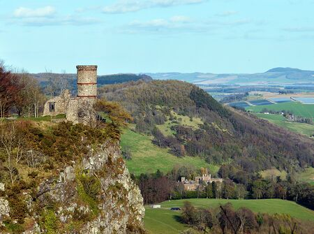 eighteenth: Kinnoull Tower, an eighteenth century folly sits atop Kinnoull Hill, Perth, Scotland, with Kinfauns Castle, built 1822-1826, in the distance. Editorial