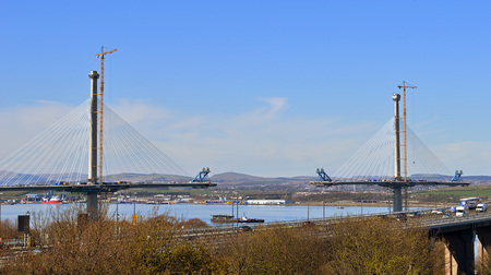 forth: The new road bridge across the Forth, the longest three-tower, cable-stayed bridge in the world nears completion at Queensferry, Edinburgh, with the old bridge in front.
