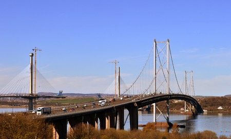 forth: The new road bridge across the Forth, the longest three-tower, cable-stayed bridge in the world nears completion with the old bridge beside it.
