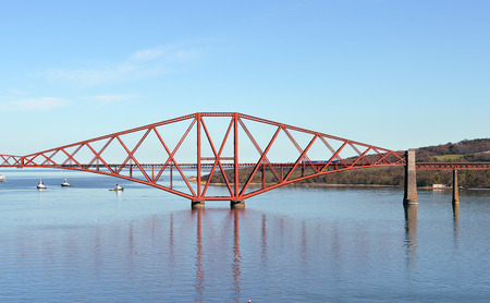 forth: A train coming from Edinburgh enters the first span of the iconic Forth Railway Bridge at South Queensferry.