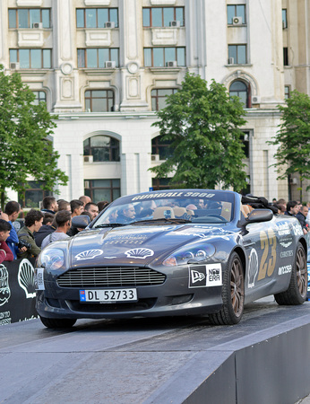 gumball: BUCHAREST, ROMANIA - 6 MAY 2016:  Team Norways Aston Martin, the first car to come down Unirii Boulevard at the end of the 18th Gumball 3000 rally, this year from Dublin to Bucharest.