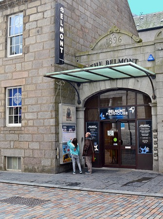 listings: ABERDEEN, SCOTLAND - 11 DECEMBER 2015: Checking the listings at the Belmont Cinema.