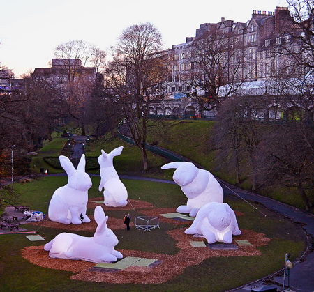 parer: ABERDEEN, SCOTLAND - 11 DECEMBER 2016:  As evening falls on Union Terrace Gardens, the giant inflatable rabbits in an installation by Australian artist Amanda Parer start to glow. Editorial