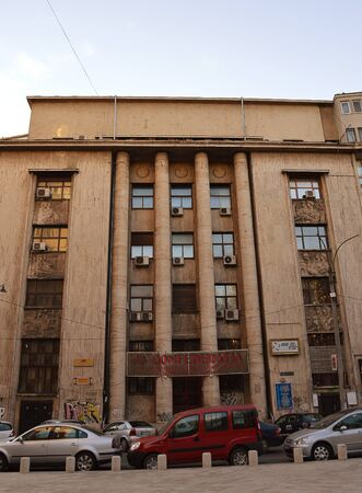 BUCHAREST, ROMANIA -13 MAY 2016:  The neglected UGIR building, designed by Mosinschi, built by Emil Prager in 1938, displays elements of art deco, modernism and the fascist style of Mussolinis Italy