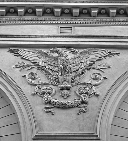 scrollwork: Sculpted eagle on a back wall of the Romanian Athenaeum, Bucharest, Romania