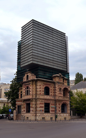 french renaissance: BUCHAREST, ROMANIA - 21 MAY 2016: The Union of Romanian Architects building icombines modern architecture on the top with the French Renaissance style building burned down in the 1989 revolution.