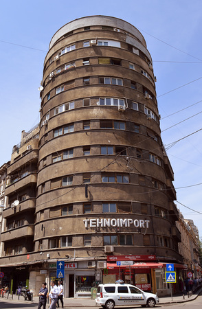 modernism: BUCHAREST, ROMANIA 1 JUNE 2016: Built in 1935, the Tehnoimport Bloc is an important example of cylindrical form in modernism. A listed building, it is categorised as at major risk from earthquakes.