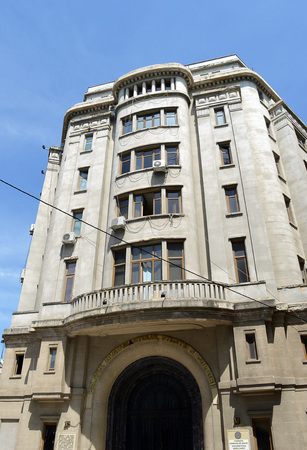 ion: BUCHAREST, ROMANIA - 1 JUNE 2016: Built 1938, in modernist style with art deco features, as headquarters of Bucharest Credit Unions this building in Ion Ghinca street is now Haru Spiret University. Editorial