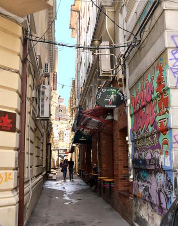 parlours: BUCHAREST, ROMANIA - 1 JUNE 2016: The narrow alleyways off Strada Lipscani in Bucharests Old Town are home to shops, bars, reatuarants and massage parlours.