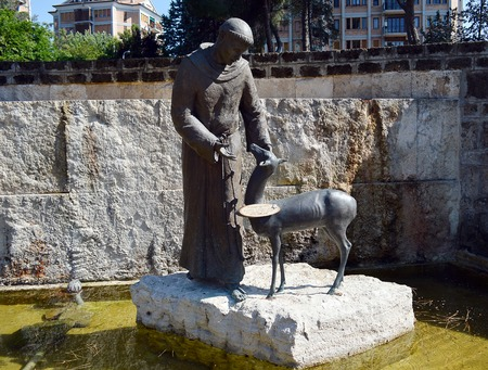 francis: Statue of St Francis of Assisi in fountain, restored by local voluntary group in Rome