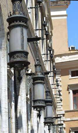 archtecture: Ornamental lights on palace, Rome, Italy