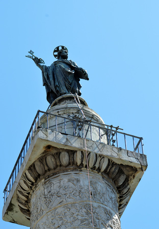 mediaeval: A bronze mediaeval statue of St Peter placed on top of the 2nd century Trajans Column in Rome by Pope Sixtus V in 1587. Editorial