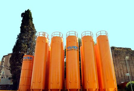 specialised: ROME, ITALY - 2 JULY 2016:  Silos from SAOS srl for the construction of specialised foundations for the new Rome metro line stand close to the Colosseum. Editorial