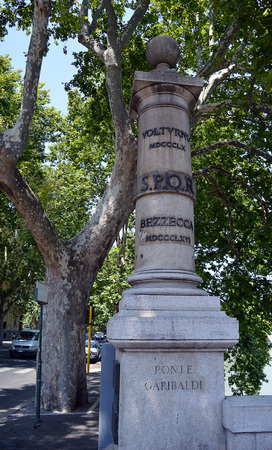 spqr: A pillar on the Garibaldi bridge commemorating two battles, Volturno and Bezzecca in the 2nd Italian War of Independence.