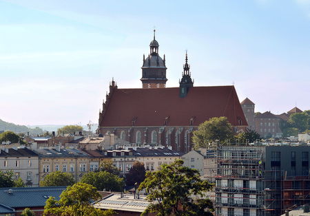Evening view across the rooftops of Krakow to the Corpus Christi Basilica, founded in 1335. Stock Photo