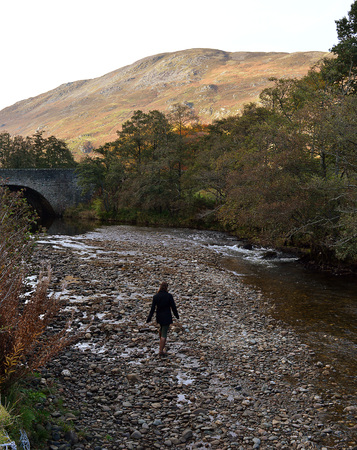 unidentified: An unidentified young woman stands on stones at the edge of the River Almond, beside General Wades military bridge, in the Sma Glen, Perthshire, Scotland